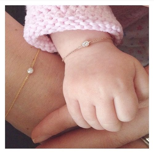 Mother-daughter bracelet set. There's something so sweet about a tiny hand wearing a delicate little piece of jewelry.