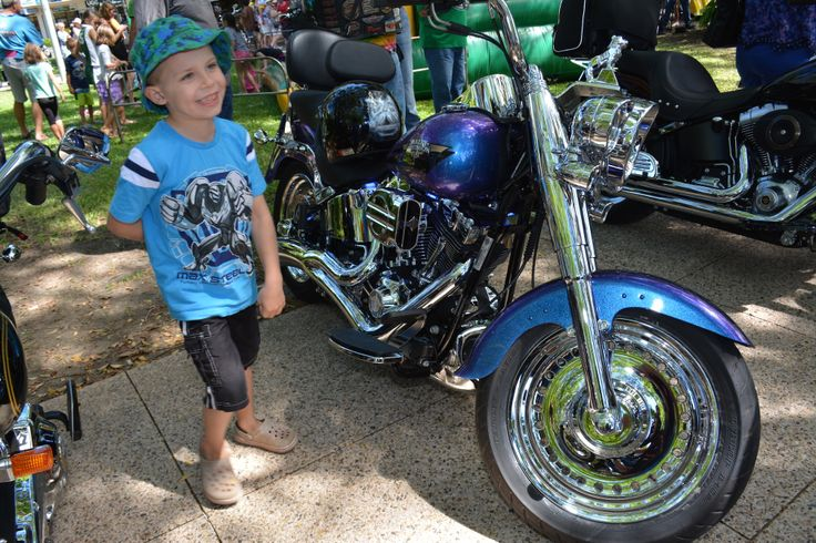 Kids love the big Hogs at the 2014 Australian HOG Rally in Cairns. Read all about it at http://motorbikewriter.com/hog-rally-success-story/