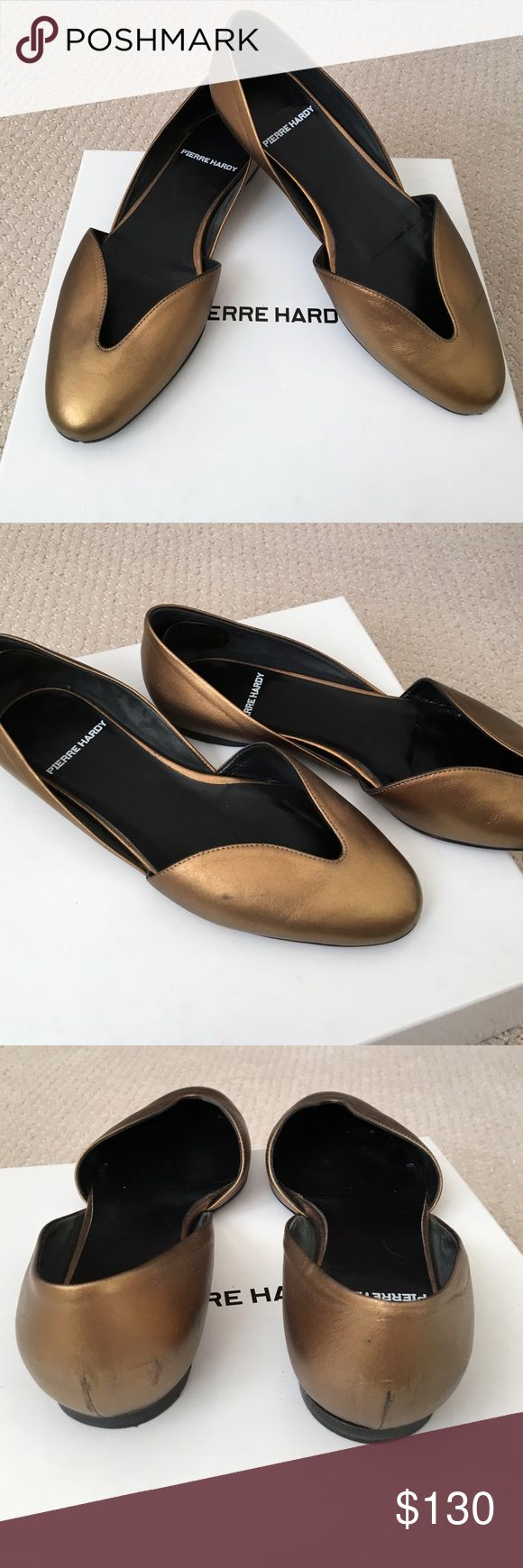 Pierre Hardy gold flats Good used condition. A few signs of wear as shown in above pictures.  Color is a bronze gold. Pierre Hardy Shoes Flats & Loafers