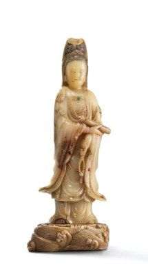 A SOAPSTONE STANDING FIGURE OF GUANYIN  LATE MING-EARLY QING DYNASTY, 17TH CENTURY