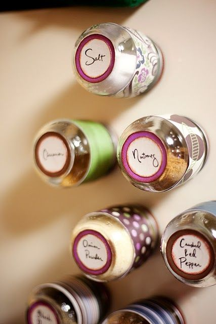 Upcycle baby food jars into magnetic spice jars that are hidden on a the side of the fridge or a magnetic board in the kitchen.