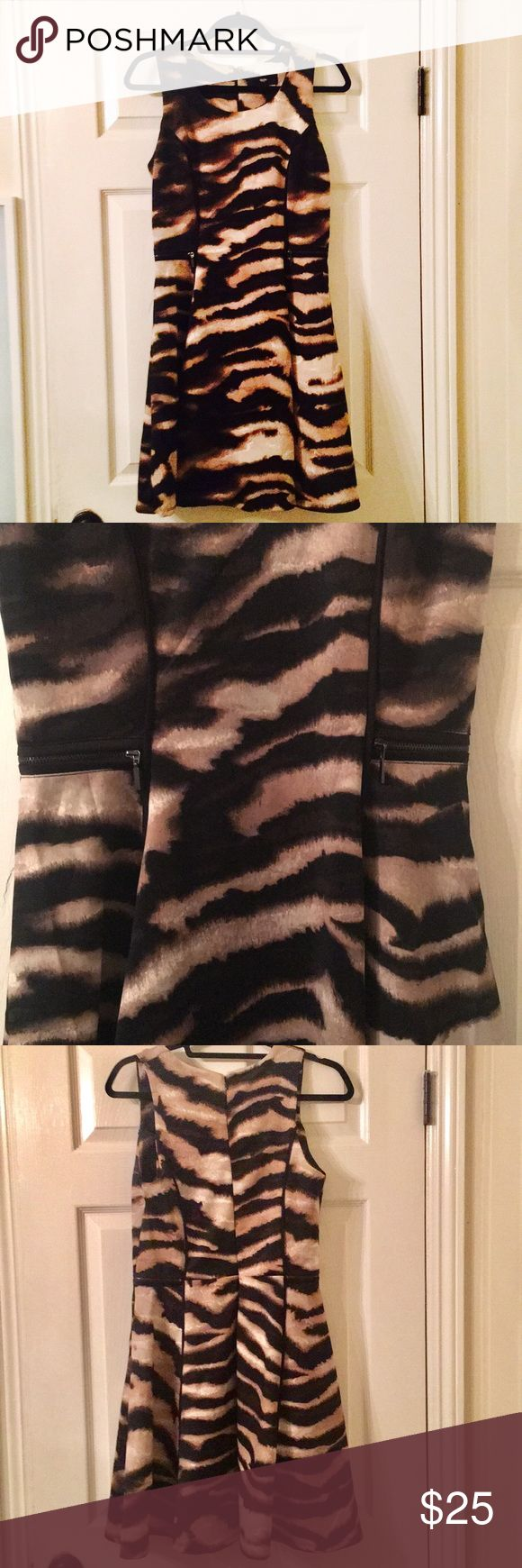 MOSSIMO Gorgeous Animal Print Dress MOSSIMO Animal Print Sleeveless Dress for Work/Evening/Cocktails with beautiful shades of Brown, Black and Cream. Knee length. Only wore it once. Mossimo Supply Co Dresses Mini