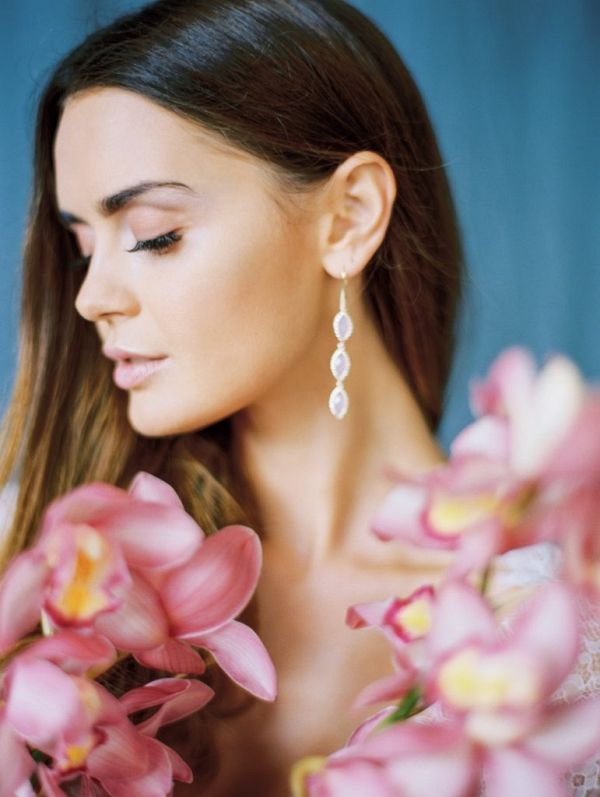 Bridal portrait with blue background and pink orchid display | Olga Siyanko Photography on @blovedblog via @aislesociety