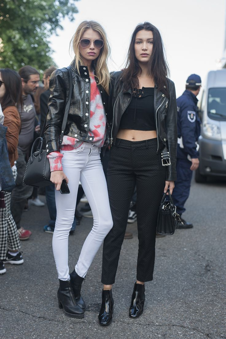 The coolest off-duty model styling at Milan Fashion Week was laid back washed denim, black jeans and crop tops paired with leather biker jackets.