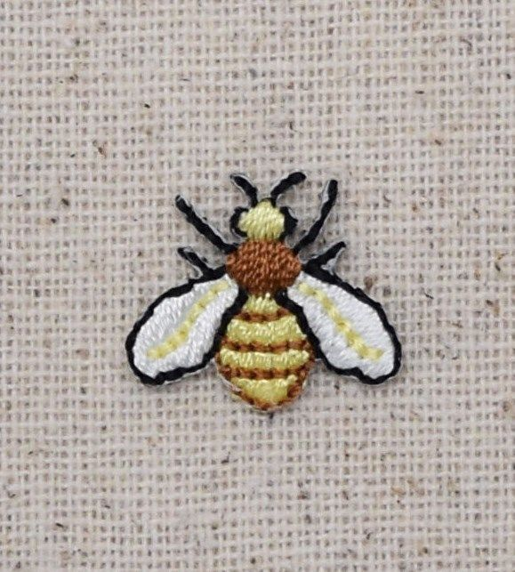 "Small Bee Iron on Applique High quality, detailed embroidery applique. Can be sewn or ironed on. Great for hats, bags, clothing, and more! Size is approx. 3/4"" or 1.9cm"