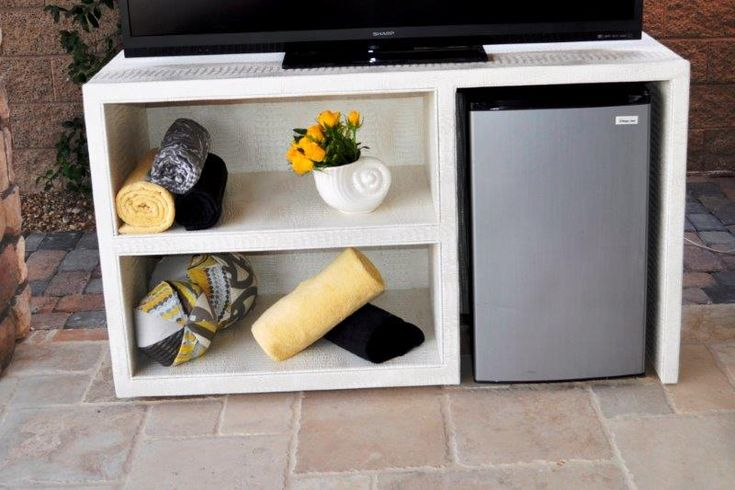 Modern and sleek! Check out this TV stand that Somers Furniture designed, not only does it work perfectly for storage, but it fits a mini fridge too!