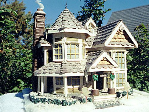House Replica ~   Wendell Graber of Prescott, AZ, is a carpenter, and he built his family's own home. That's what inspired Graber and his daughters, Hannah, 10, and Kiersten, 7, to make this gingerbread replica of their home out of Cinnaburst gum, Cinnamon Toast Crunch, spinach linguini and grape Bubble Tape