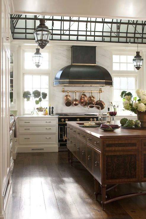 Possibly most gorgeous kitchen island ever!    Suzie: Austin Patterson Disston - Gorgeous French kitchen with black Dome kitchen island with ...