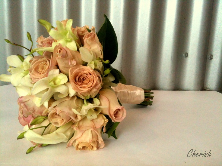 Lilac and Caramel roses, white dendrobium orchids and white calla lilies with camellia foliage.... one of my favourite creations to date