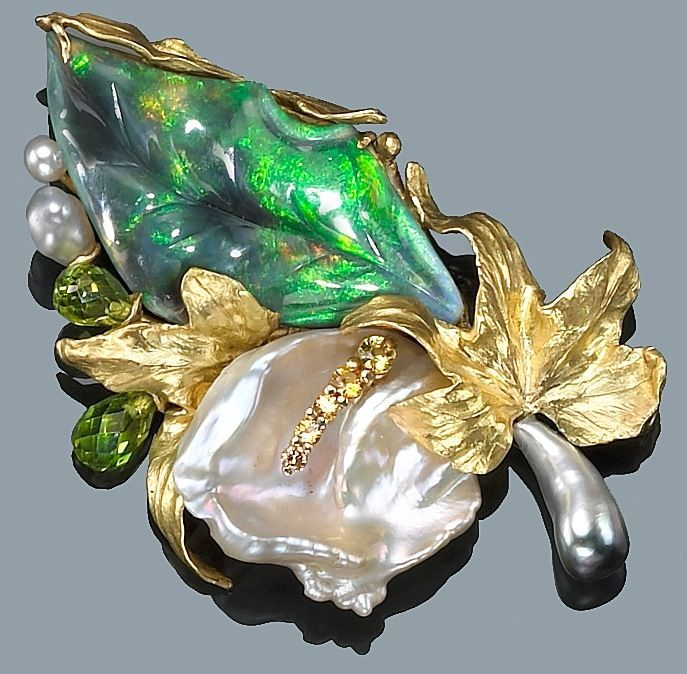 Brooch by Angela Conty. A 16.75ct black opal from Lightning Ridge, yellow sapphires, South Seas Keshi pearl, peridot briolettes and freshwater pearls set in 18kt gold. (Bonham's)