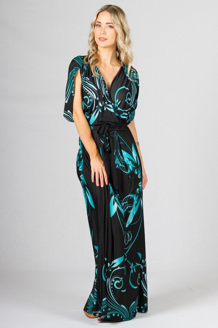 """Paper Scissors Frock Batwing Long Maxi Dress - Leaf Pattern. Long Batwing style maxi with deep cross-over look front, box pleating, gathering on the sleeves & batwing style sleeve. Comes with a removable belt in the same fabric as the frock.  Made from high quality ITY polyester.  Pictured Models is 5'8"""""""