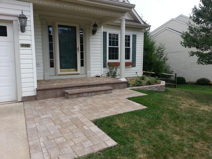 A Porch Overlay With Paver Brick And A New Sidewalk