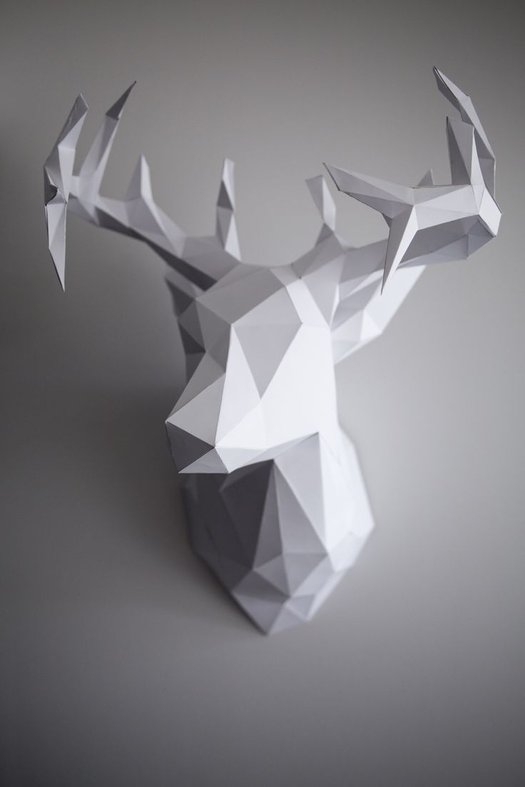 My thumb may still be numb from cutting this out but my goodness was it  worth it! Say hello to my newest friend. Just in time for the Christmas  holidays this 3D paper reindeer head is bound to wow your guests! Hang it  for the holidays or all year round.. this sculpture is modern, edgy  (literally), and the perfect statement art piece. If you're interested in  trying this out for yourself you can follow my step by step tutorial here:  Instructions and Template: CLICK HERE