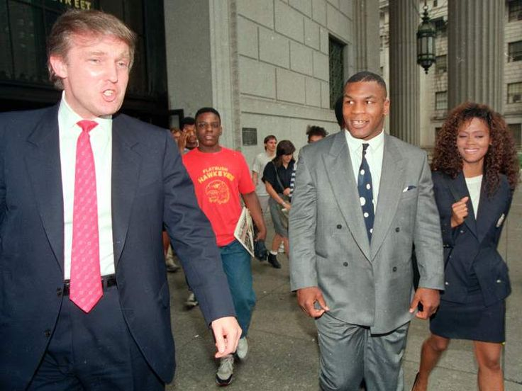 Heavyweight champion Mike Tyson, his wife, actress Robin Givens and Donald Trump, leave the New York State Supreme Court building on July 22, 1988.