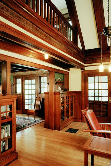 """True"" Craftsman Style Home. Turn from the entry hall towards the living room and this is your first view of the soaring ceilings and balcony above the dining room..  Original woodwork, light fixtures and embossed wall paper frieze, are highlights of this grand room."