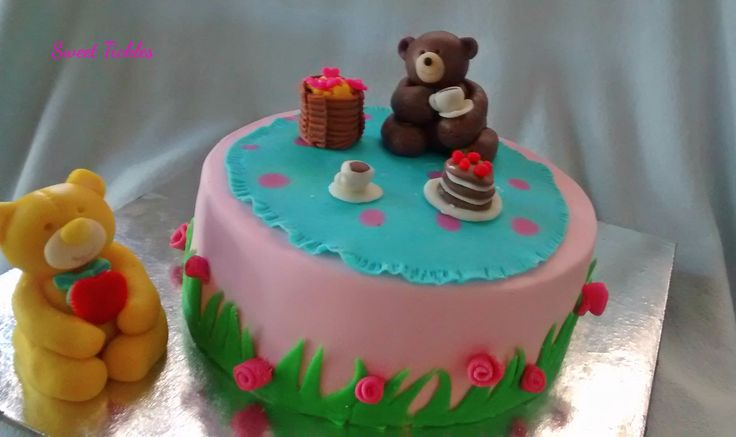 Fondant covered cake with chocolate and black current flavour.