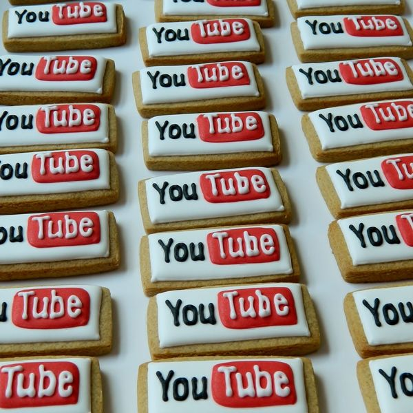 Birthday decorated sugar cookies for him. Royal icing. White, red, black. YouTube logo.