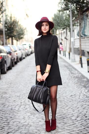 date night outfit idea - three quarter sleeve mini turtleneck dress, worn with sheer tights + suede burgundy ankle boots and a matching hat