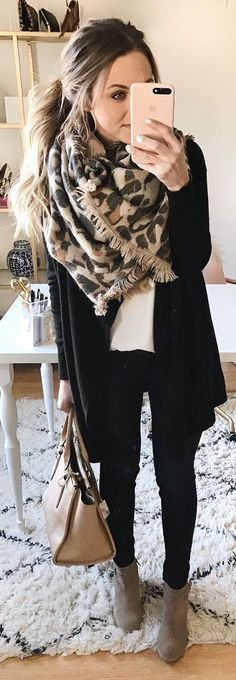 Black over white top with animal print scarf.