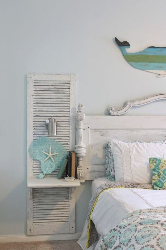Shutter repurposed as a night table in a shabby chic bedroom