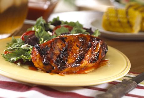 Chicken on the grill is basted with a honey-and-mustard kissed tomato sauce.