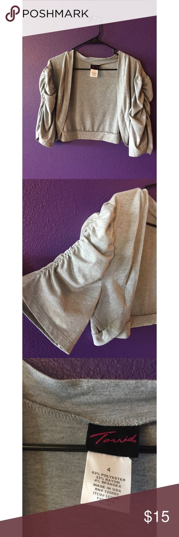 Torrid Grey Shrug with Ruched Sleeves Grey Shrug from torrid. Super cute with tanks and sleeveless dresses. Sleeves fall above elbow. Never worn torrid Sweaters Shrugs & Ponchos