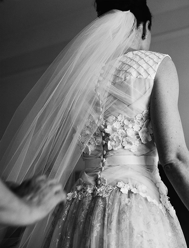 Silk tulle, silk satin, and Chantilly lace gown, with hand beading and appliqué flowers, and net underskirt