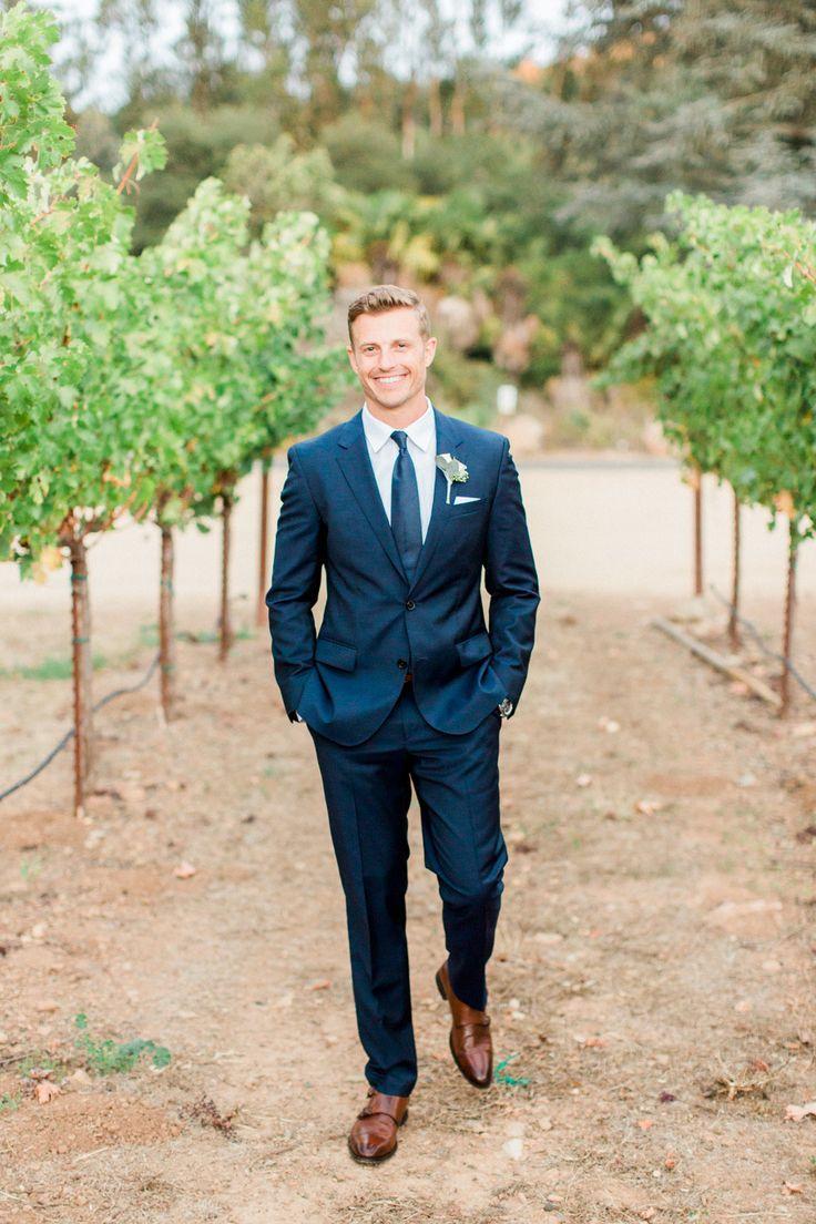 Groom's Attire: Hugo Boss Red Label - http://www.stylemepretty.com/portfolio/hugo-boss-red-label Photography: Koman Photography - komanphotography.com/   Read More on SMP: http://www.stylemepretty.com/california-weddings/2016/02/03/rustic-elegant-fall-wedding-at-chateau-st-jean/