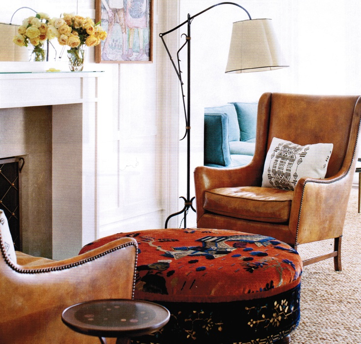 Brown leather chairs, adjustable lamp, patterned ottoman