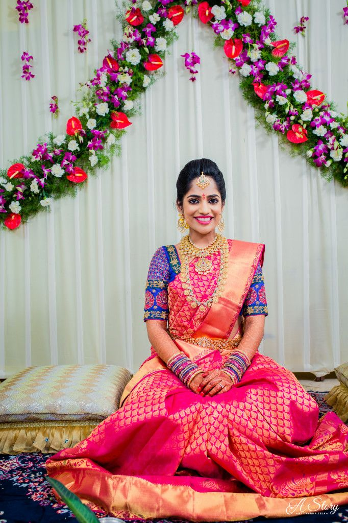 South Indian bride. Gold Indian bridal jewelry.Temple jewelry. Jhumkis.Pink silk kanchipuram sari with contrast blue blouse.braid with fresh jasmine flowers. Tamil bride. Telugu bride. Kannada bride. Hindu bride. Malayalee bride.Kerala bride.South Indian wedding.