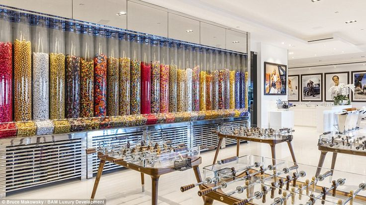 Inside the mega-mansion lies a candy room (pictured) filled with $200,000 worth of treats ...