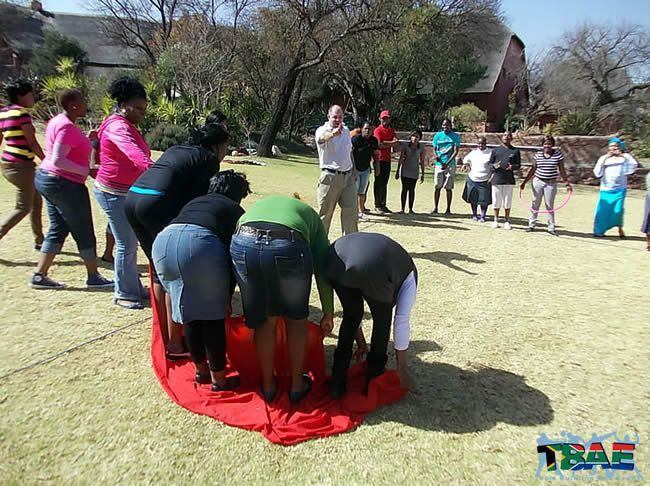 Magic Carpet - Each team member needs to stand on the small carpet. The carpet then needs to be turned over without any body part of each team member touching the floor. Some interesting body positions!