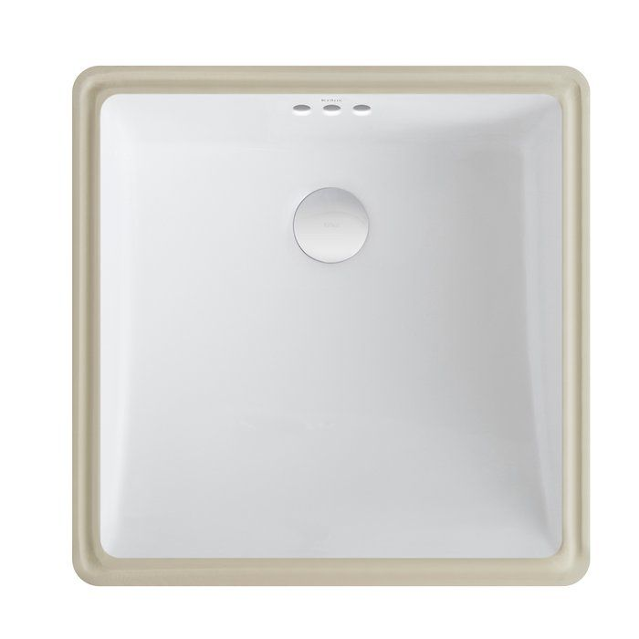 """The new series of bathroom sinks from Kraus offers a fresh take on classic white ceramic. The square shape of this undermount basin complements a range of décor styles, from traditional to contemporary. The smooth, non-porous surface is naturally hygienic and durable, with a premium baked-on glaze for an easy-to-clean high-gloss finish. This model is ideal for retrofitting, with a 1 3/4"""" drain opening designed for standard US plumbing connections. Pair this sink with a Kraus centers..."""
