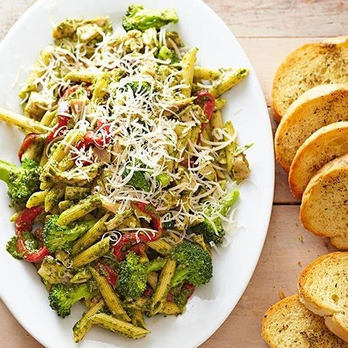 Pesto pasta with cheese a popular Italian dish which you can buy at most Italian restaurants and many people use as there own recipes; Italian food which was introduced in the 1920s