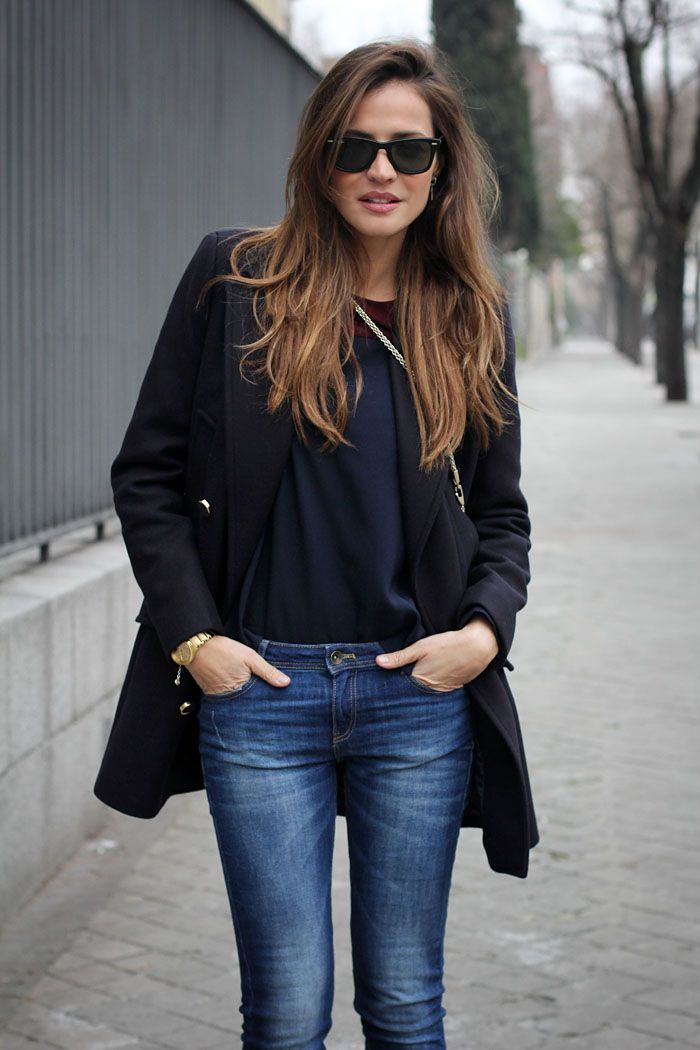 Blue jeans and black long coat