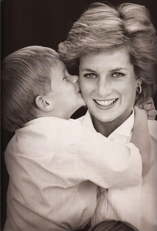 Prince Harry kisses his mother Princess Diana; 1988.
