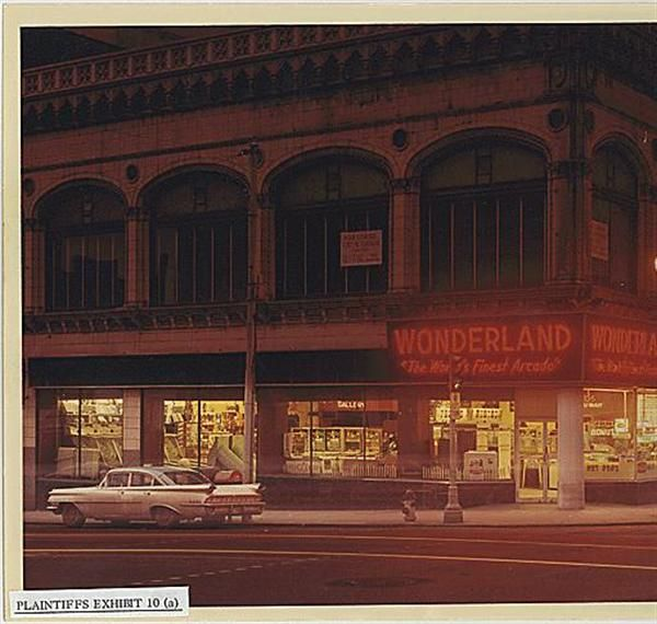 Wonderland Arcade, 1200 Grand Ave. Kansas City, Missouri, 1968. One exterior image, also collected are interior shots. Pinball machines, a shooting gallery, self photograph booths, a private recording studio, food area with the menu on the wall, popcorn machine & other typical arcade games.