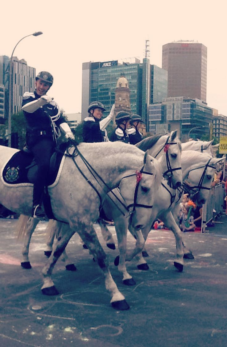 Mounted Operations Unit wave to the crowd at Victoria Square (Tarntanyangga) during the 2014 Christmas Pageant. #Adelaide #Christmas #Pageant