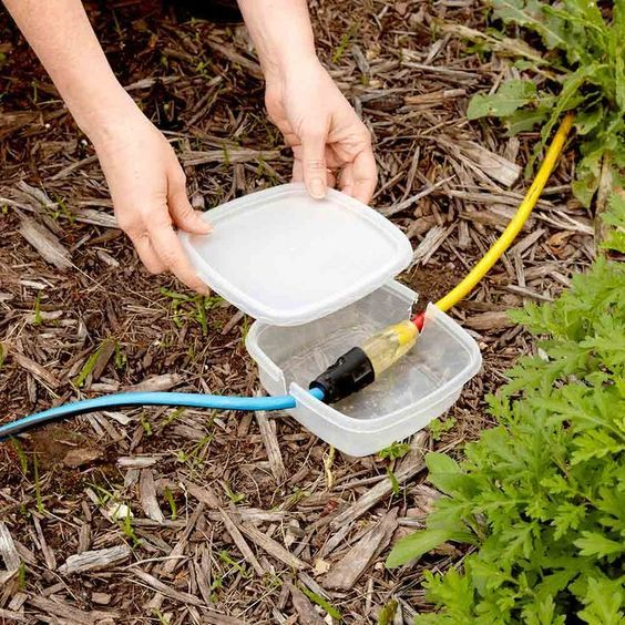 Temporary Extension Cord Protection - If you're having a party or some other event in the yard and you need additional electricity sources, here's a great way to keep extension cord plugs dry. Cut notches in the opposite sides of a reusable plastic container and snap on the lid. Your plugs will stay dry if it happens to rain or the ground is moist.