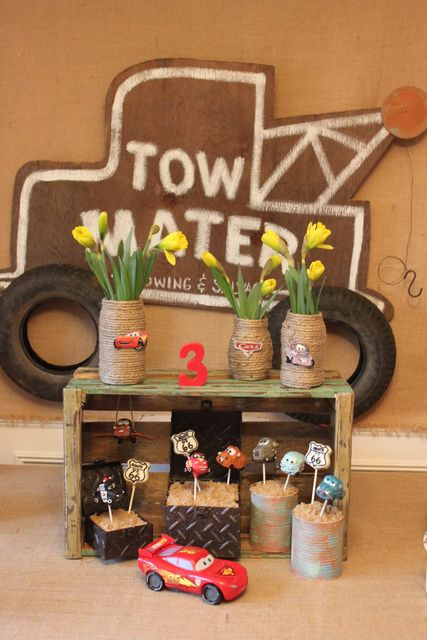 Tow Mater sign made by Triple M Good Parties  Cake pops by Evie and Mallow  Crate from Mariah Rainer  Jute jars by Triple M Good Parties