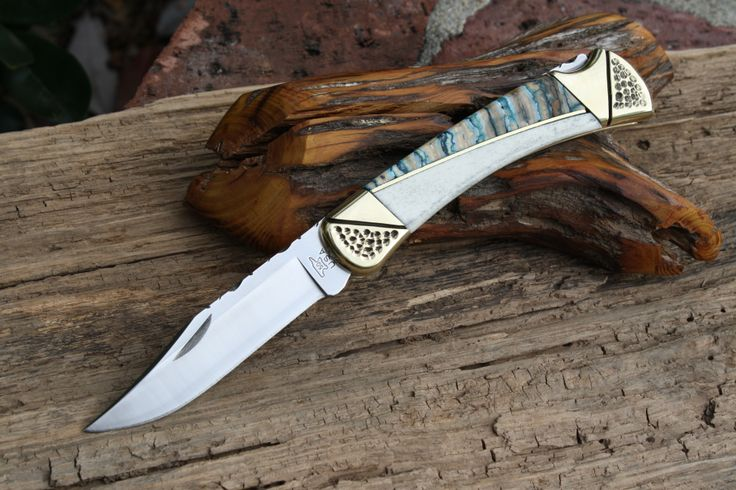 Buck 110 by Cameron Custom Cutlery featuring mammoth tooth and camel bone