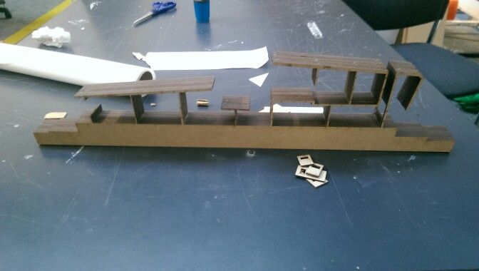 Laser cut sectional model group housing assignment