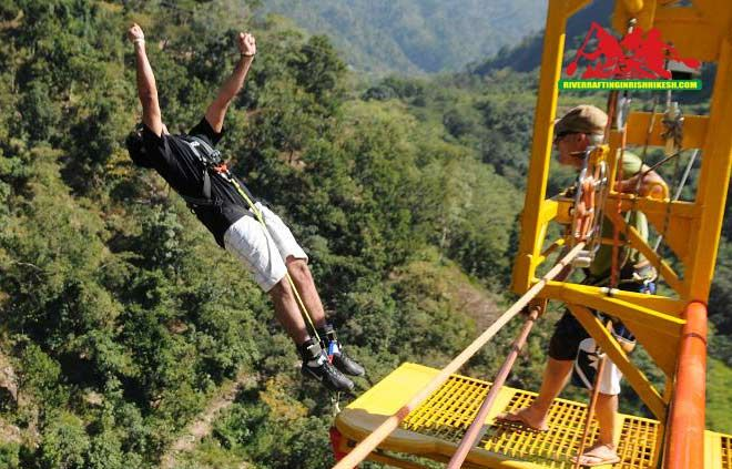 Bungee jumping offer first fixed plateform in Rishikesh India, A Cantilever built over a rocky cliff over looking a rocky river HALL, a side stream of River Ganga. Jump with rubber chords tied to your ankle and feel the adrenalin rush like never before. Rishikesh bungee jumping height - 83 MTRS