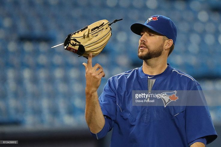 TORONTO, ON- OCTOBER 8 - Toronto Blue Jays relief pitcher Ryan Tepera balances his glove as Toronto Blue Jays and Texas Rangers prepare to play game three on Sunday at the Rogers Centre in Toronto. October 8, 2016.