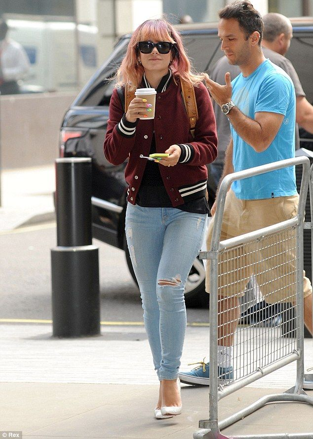 Lily Allen in jeans and varsity jacket.