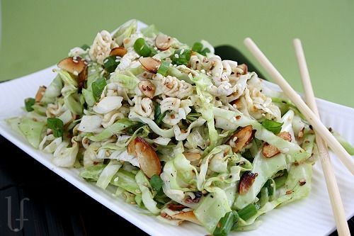 (My dad made this once and lost the recipe! Yay I found it!) :D Oriental Cole Slaw is a BILLION times better than regular cole slaw!! It has toasted almonds, crunchy ramen noodles, cabbage, seasame seeds & a drizzle of oil.  Try it! I promise you won't be disappointed :)  OMG it sounds like applebee's oriental chicken salad! :DDDD