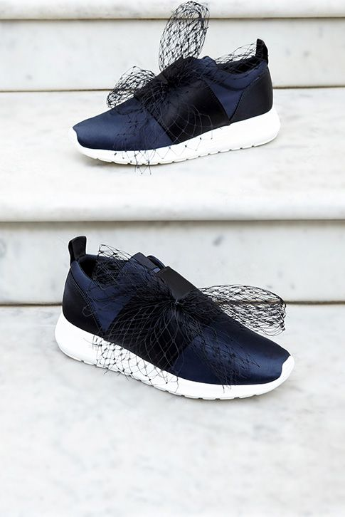 A sneaker with unmistakable sass, Letty by Kurt Geiger London brings high-fashion attitude by the bucketload this season. In classic navy, this sporty sneaker comes topped with head-turning netting. Team with frayed denim for easy chic.