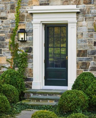 Black door, white trim and stone exterior. Side entrance ... Love