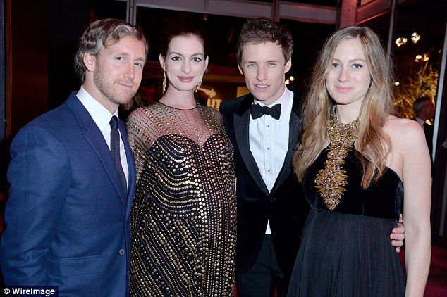 In great company: Anne and Adam posed for a snap with Eddie Redmayne and his pregnant wife...