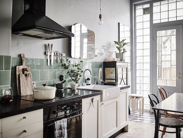 Kitchen with retro green tiles in a romantic Swedish home